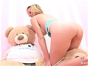 Brett Rossi plays with a stuffed bear's strap-on fuck stick