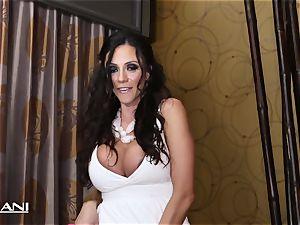 The magnificent Ariella Ferrara inserts a pink faux-cock in her
