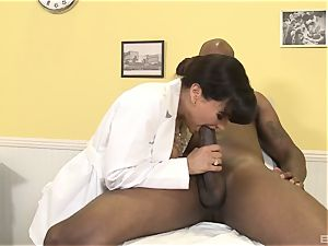 Lisa Ann jaw-dropping mummy medic