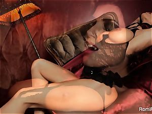 Romi the buxom vampire has a steamy solo session
