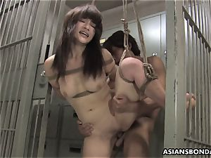 japanese bombshell gets romped with energy behind the beams