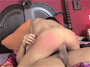 buxom Capri Cavanni drills on the couch
