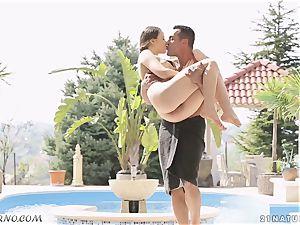 youthfull Russian Taissia Shanti having intercourse by the pool