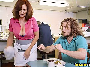 busty sandy-haired mature waitress flashes bumpers for a bigger apex