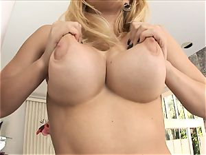 blonde babe Kagney Karter plays with her large bra-stuffers