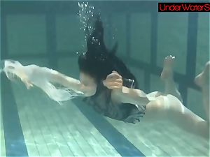 Blackhaired ultra-cutie Irina underwater