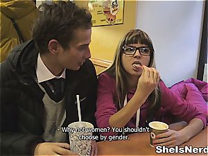 smallish nerdy woman takes juice on her specs